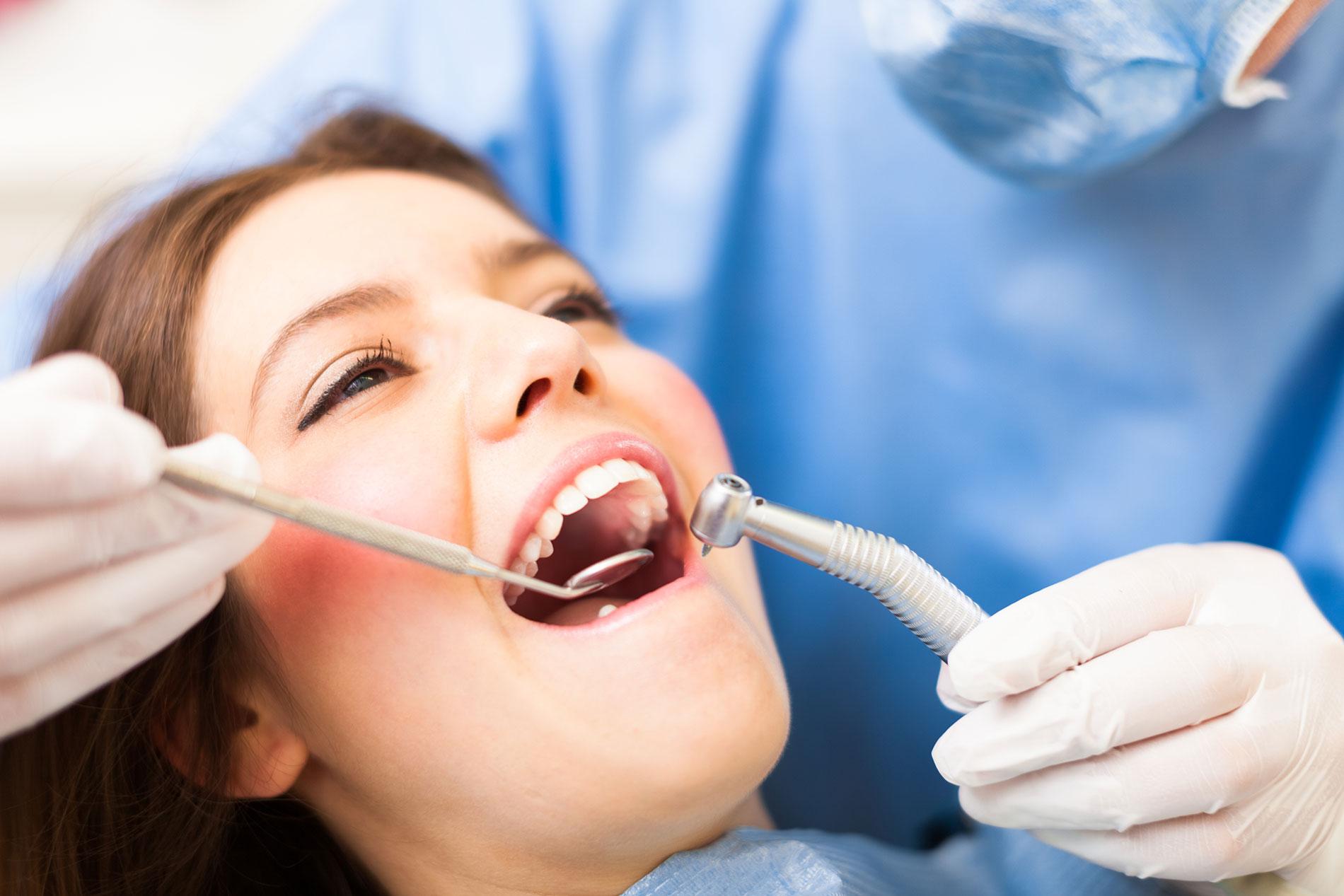 Dental Insurance - woman at dentist