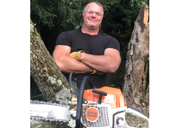 Dave Coil with his chainsaw