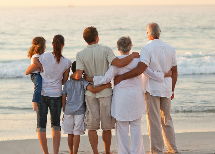 Family and grandparents on the beach.