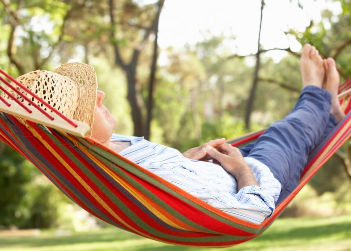 Man relaxing in hammock in retirement.