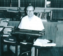 Paul Hummel in front of his typewriter.