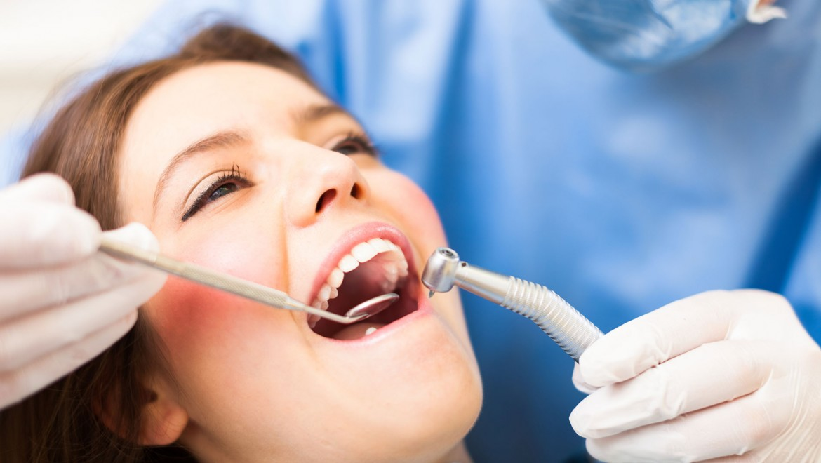 Dental Insurance - woman at dentist