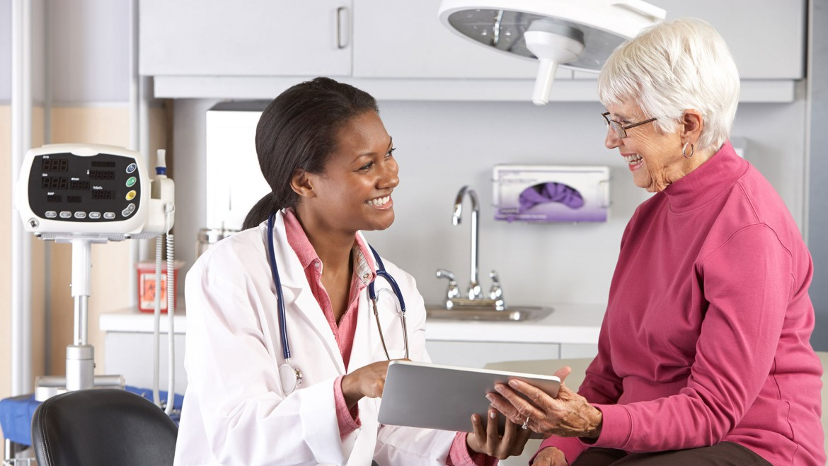 Medical Malpractice Insurance - Doctor speaking with patient