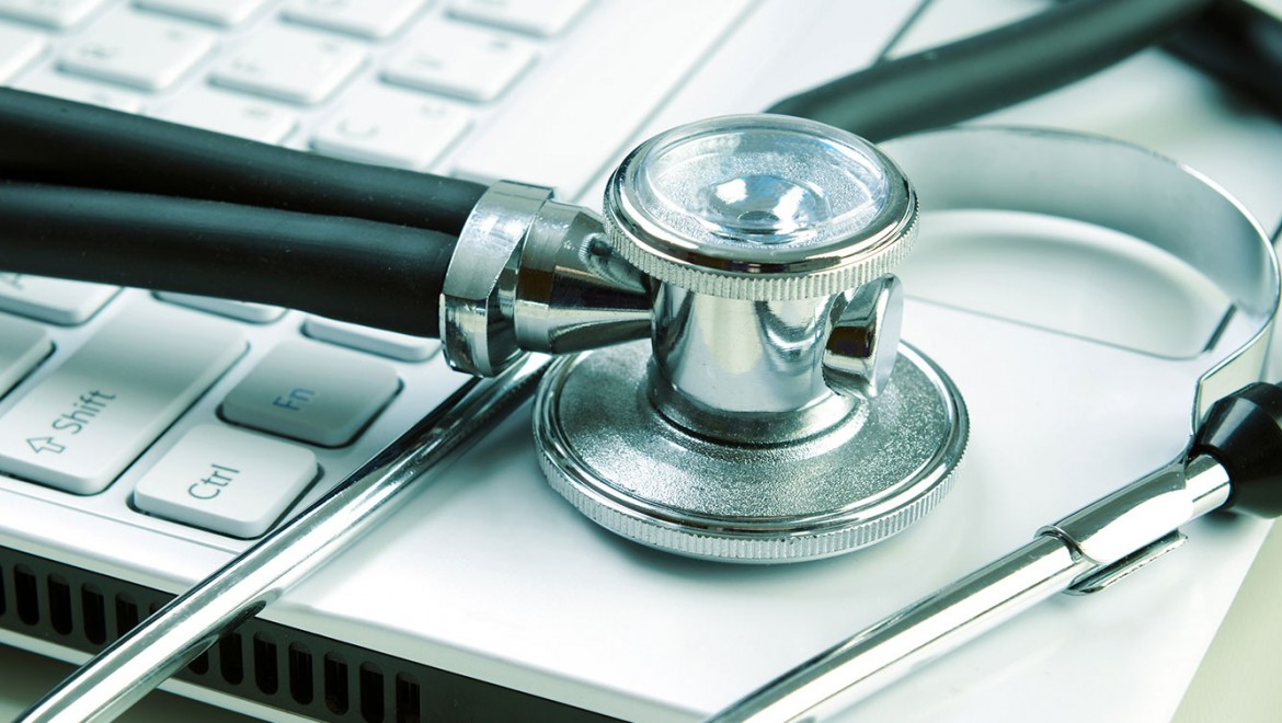 Medical Malpractice Insurance - Stethoscope on laptop