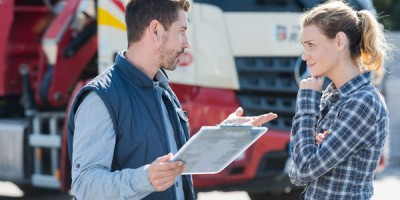 male and female truck drivers talking