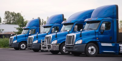 four blue trucks lined up