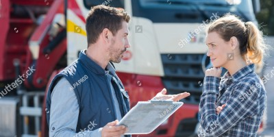 two truck drivers talking