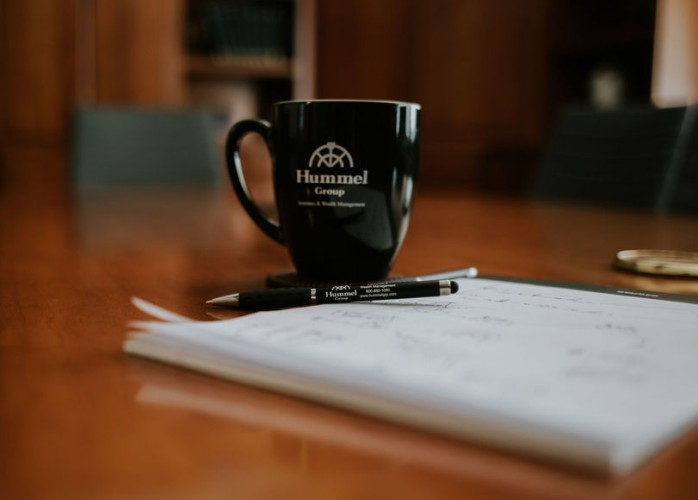 Hummel coffee cup on conference room table