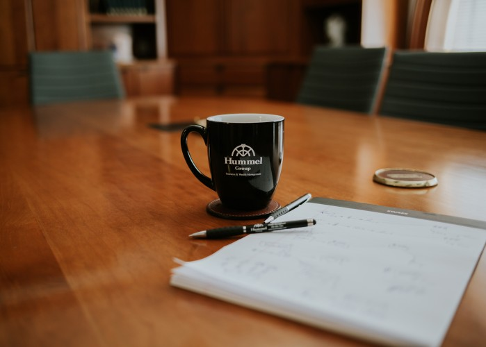 image of Hummel mug on conference table with notepad and pen
