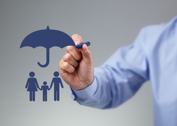 image of man drawing umbrella that is protecting a family